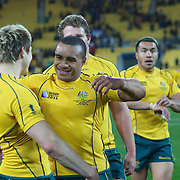 """Will Genia, Australia, (facing) celebrates with James O""""Connor after Australia's victory during the South Africa V Australia Quarter Final match at the IRB Rugby World Cup tournament. Wellington Regional Stadium, Wellington, New Zealand, 9th October 2011. Photo Tim Clayton..."""