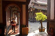A woman walks through Boai Daoist Temple in Taipei, Taiwan.