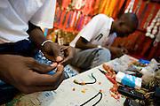 Men make jewelry at the Village Artisanal de Ouagadougou, a cooperative that employs dozens of artisans who work in different mediums, in Ouagadougou, Burkina Faso, on Monday November 3, 2008.