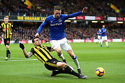 Watford's Daryl Janmaat (left) and Everton's Gylfi Sigurdsson (right) battle for the ball during the Premier League match at Vicarage Road, Watford.