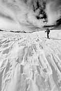Backcountry skier under Piute Pass, John Muir Wilderness, Sierra Nevada Mountains, California USA
