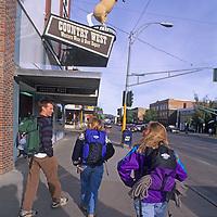 College students walk down Main Street in downtown Bozeman, Montana.