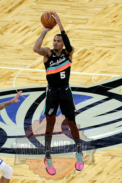 ORLANDO, FL - APRIL 12: Dejounte Murray #5 of the San Antonio Spurs attempts a shot against the Orlando Magic during the first half at Amway Center on April 12, 2021 in Orlando, Florida. NOTE TO USER: User expressly acknowledges and agrees that, by downloading and or using this photograph, User is consenting to the terms and conditions of the Getty Images License Agreement. (Photo by Alex Menendez/Getty Images)*** Local Caption *** Dejounte Murray