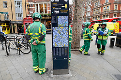© Licensed to London News Pictures. 03/02/2020. LONDON, UK.  Ambulance staff stand by as Old Compton Street is evacuated.  Scenes in Soho where the public are being evacuated by police and emergency services are in attendance after reports of an unexploded WW2 bomb being discovered in the area.  A wide cordon is being established from Shaftesbury Avenue, Charing Cross Road and the streets around Old Comption Street.  Photo credit: Stephen Chung/LNP