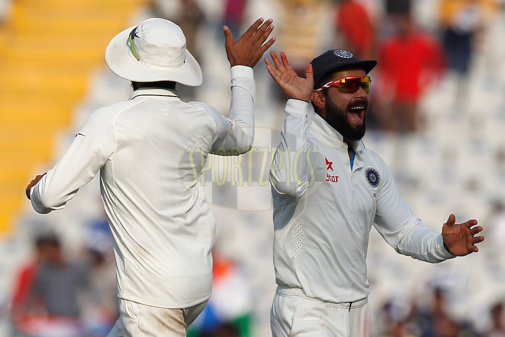 Virat Kohli Captain of India celebrates the wicket of Moeen Ali of England during day 3 of the third test match between India and England held at the Punjab Cricket Association IS Bindra Stadium, Mohali on the 28th November 2016.<br /> <br /> Photo by: Deepak Malik/ BCCI/ SPORTZPICS