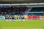 The teams line up for a minutes silence before the match to in support of the victims of terrorism before the Sky Bet League 2 match between Plymouth Argyle and York City at Home Park, Plymouth, England on 28 March 2016. Photo by Graham Hunt.