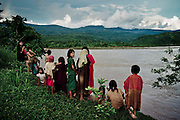 Ashaninka children watch the Ene River in front of their village of Boca Sanibeni, in an area that would be flooded by Pakitzapango Dam, Peruvian amazon. April 2012. Photo/Tomas Munita