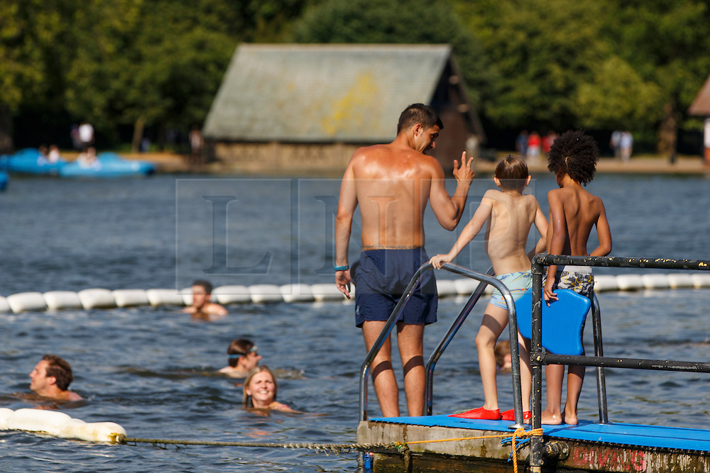 © Licensed to London News Pictures. 20/07/2016. London, UK. People swim and enjoy hot weather at the Serpentine pond in Hyde Park, London as temperatures hit 27C degrees across the capital on Wednesday, 20 July 2016. Photo credit: Tolga Akmen/LNP