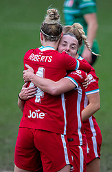 BIRKENHEAD, ENGLAND - Sunday, March 14, 2021: Liverpool's Becky Jane (R) celebrates with team-mate Rhiannon Roberts after scoring the second goal during the FA Women's Championship game between Liverpool FC Women and Coventry United Ladies FC at Prenton Park. Liverpool won 5-0. (Pic by David Rawcliffe/Propaganda)