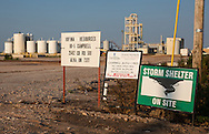 Storm shelter sign at a salt water disposal site for the fracking industry , in Alva, Oklahoma. Alva is in Woods County in the Northwestern part of the state where the fracking industry is booming.