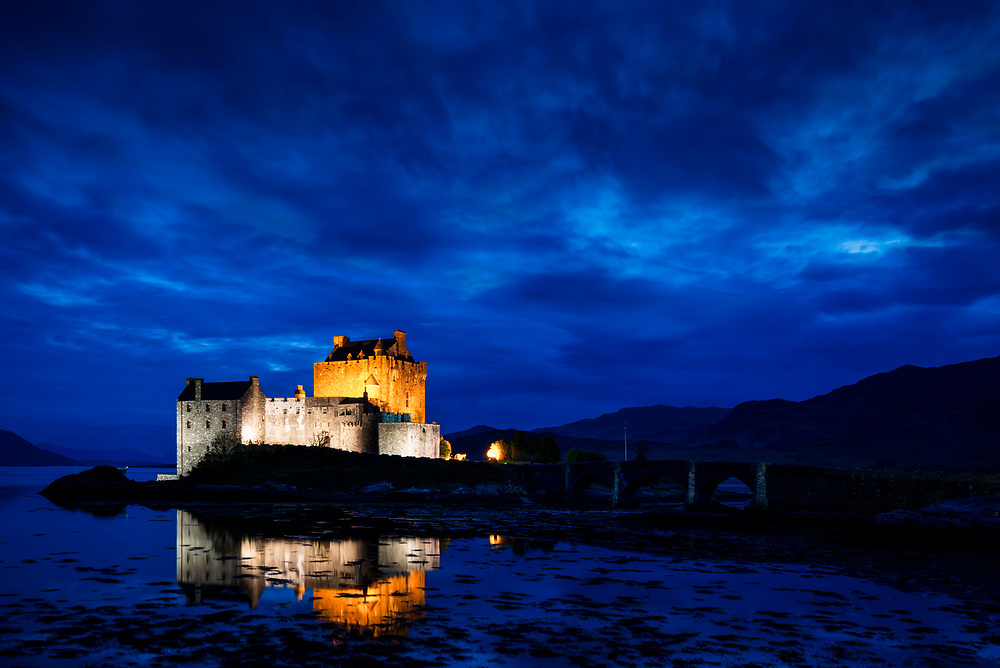 """Eilean Donan means the """"island of Donan"""" and is named after Donnán of Eigg, a Celtic saint martyred in 617. The castle governs the confluence of three tidal lochs - Loch Duich, Loch Long and Loch Alsh - in the western Highlands of Scotland near the town of Dornie."""