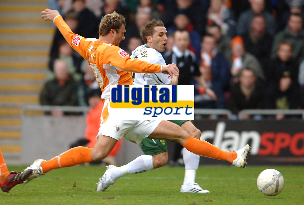 Photo: Paul Greenwood.<br />Blackpool v Norwich City. The FA Cup. 27/01/2007. Norwich's Darren Huckerby, right, shoots past Blackpool's Ian Evatt.