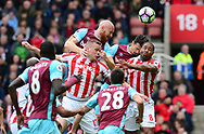 James Collins of West Ham wins a header over Ryan Shawcross of Stoke city. Premier league match, Stoke City v West Ham Utd at the Bet365 Stadium in Stoke on Trent, Staffs on Saturday 29th April 2017.<br /> pic by Bradley Collyer, Andrew Orchard sports photography.