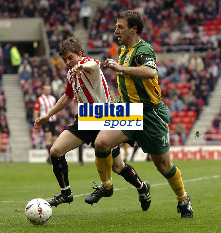 Photo. Glyn Thomas.<br /> Sunderland v West Bromwich Albion. <br /> Nationwide Division 1. 18/04/2004.<br /> Sunderland's John Oster (L) battles for the ball with Sean Gregan.