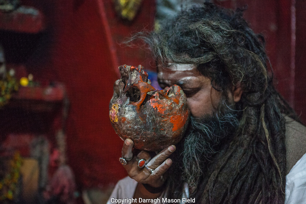 Shri Baba Chamunda Ram, an Aghori, Tantra and Yantra yogi, drinking whiskey from the skull.