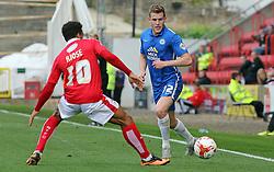 Callum Elder of Peterborough United plays the ball past Nicky Ajose of Swindon Town - Mandatory byline: Joe Dent/JMP - 07966 386802 - 10/10/2015 - FOOTBALL - County Ground - Swindon, England - Swindon Town v Peterborough United - Sky Bet League One
