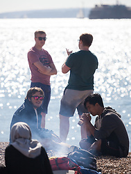 © Licensed to London News Pictures. 02/10/2016. Southsea, Hampshire, UK.  A group of students enjoying a BBQ in the warm, sunny weather on another stunning autumn day. Photo credit: Rob Arnold/LNP