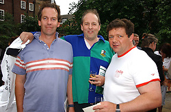 Left to right, the EARL OF COURTON, LORD REDESDALE and LORD ADDINGTON at the annual Macmillan Cancer Support House of Lords vs the House of Commons Tug of War held in Victoria Tower Gardens on 20th June 2006.<br /><br />NON EXCLUSIVE - WORLD RIGHTS