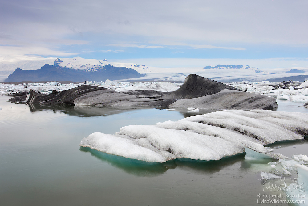 Numerous icebergs float in Jökulsárlón, the Glacier Lagoon, in southeastern Iceland. Big chunks of ice break off from the Breiðamerkurjökull glacier and float in the lagoon until they melt or are carried by changing tides out to the Atlantic Ocean.
