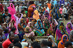 September 15, 2016 - Kaushambi, India - Indian woman supporters sit on a cot as they attend  Indian Congress party's vice president and leader Rahul Gandhi's public meeting , popularly known as Khaat Panchayats, where organizers make arrangement of thousands of Khaats (cots) for the people attending the meetings to sit on them, while listening to their leader, in tenwa village , in Kaushambi on September 15, 2016.Khaat (rustic Hindi word for cot) is symbol of villages in general and of farmers in particular. By naming the public meetings as Khaat Panchayats arranging khaats during the meetings, a strategy has been drawn to connect Rahul and Congress with the farmers of Uttar Pradesh and thus reap the electoral harvests during the next assambly elections. (Credit Image: © Ritesh Shukla/NurPhoto via ZUMA Press)