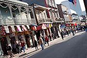 People walk down a street in New Orleans, Louisiana.