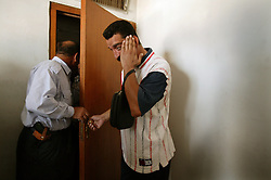 Frustrated Iraqis wait for monetary compensation for damages done by U.S. troops at a court in Baghdad, Iraq, Sept. 27, 2003. Alyaa Abdul Hassan Abbood, 23, not pictured here, a translator, will facilitates this process.