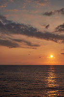 Orange colored sky and clouds over the Pacific Ocean just after sunrise. Image 5 of 10 for a wide-angle panorama taken with a Fuji X-T1 camera and 35 mm f/1.4 lens  (ISO 200, 35 mm, f/16, 1/250 sec). Raw images processed with Capture One Pro and stitched together with AutoPano Giga Pro.