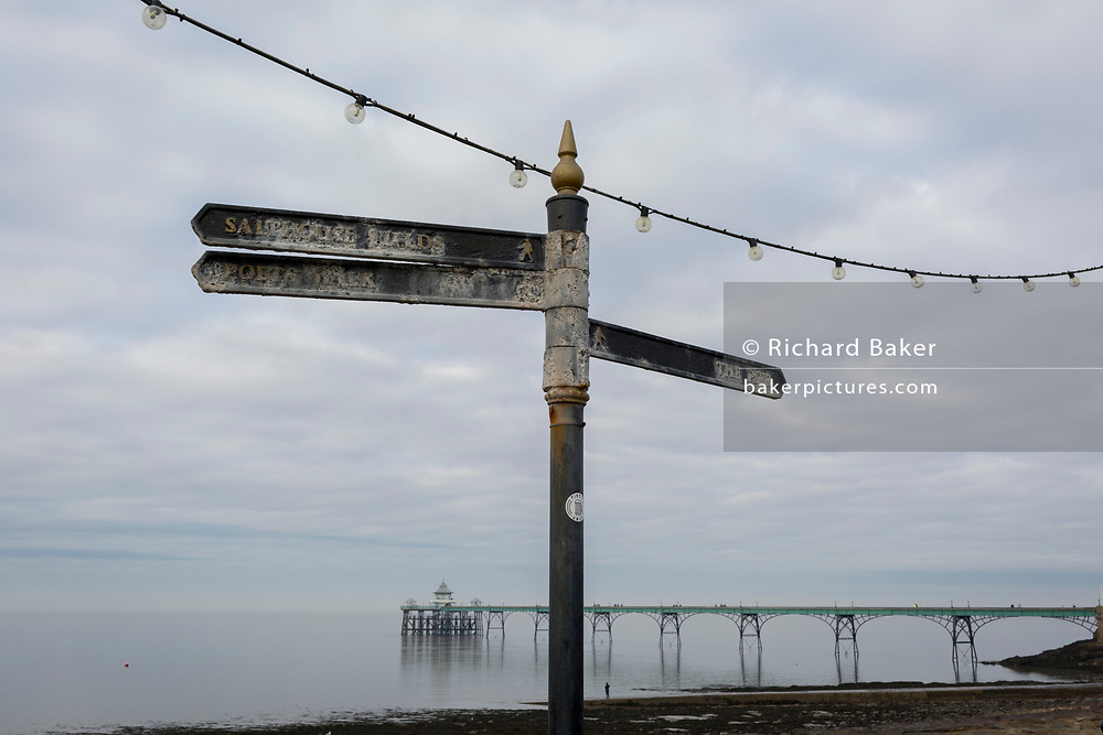 A signpost pointing to Salthouse Fields, Poets Walk and the Pier, at Clevedon Pier, on 27th December 2018, in Clevedon, North Somerset, UK.