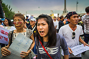 26 MAY 2014 - BANGKOK, THAILAND: People taunt riot police during a protest against the coup in Thailand at Victory Monument during a pro-democracy rally in Bangkok. About two thousand people protested against the coup in Bangkok. It was the third straight day of large pro-democracy rallies in the Thai capital as the army continued to tighten its grip on Thai life.   PHOTO BY JACK KURTZ