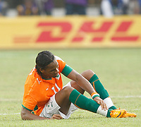Photo: Steve Bond/Richard Lane Photography.<br />Ivory Coast v Benin. Africa Cup of Nations. 25/01/2008. Didier Drogba gets a knock to the ankle