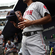 NEW YORK, NEW YORK - July 10: Xander Bogaerts #2 of the Boston Red Sox heads out of the dugout to field holding his hat and his baseball mitt during the Boston Red Sox Vs New York Yankees regular season MLB game at Yankee Stadium on July 10, 2016 in New York City. (Photo by Tim Clayton/Corbis via Getty Images)