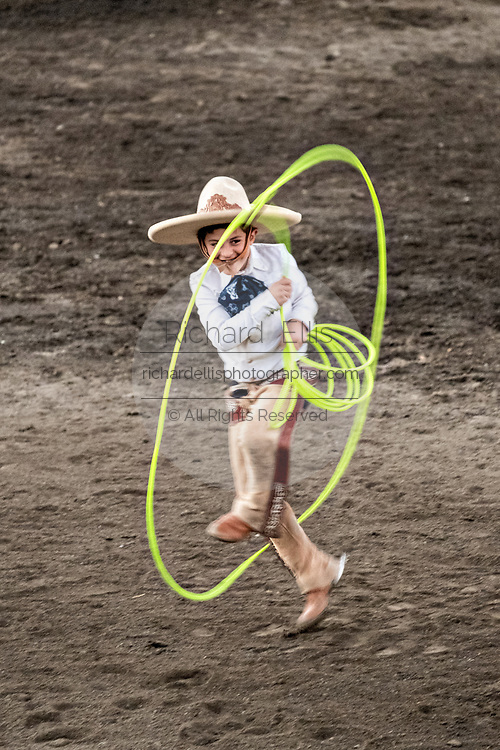 Luis Alfonso Franco, Jr. practices his rope skills during the family Charreria practice session in the Jalisco Highlands town of Capilla de Guadalupe, Mexico. The Franco family has dominated Mexican rodeo for 40-years and has won three national championships, five second places and five third places.
