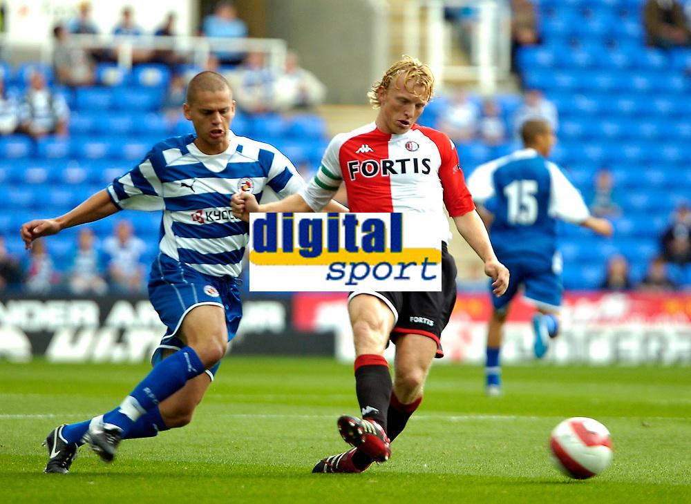 Photo: Ed Godden.<br />Reading v Feyenoord. Pre Season Friendly. 12/08/2006.<br />Dirk Kuyt (R) takes the ball past Reading's Ivar Ingimarsson.