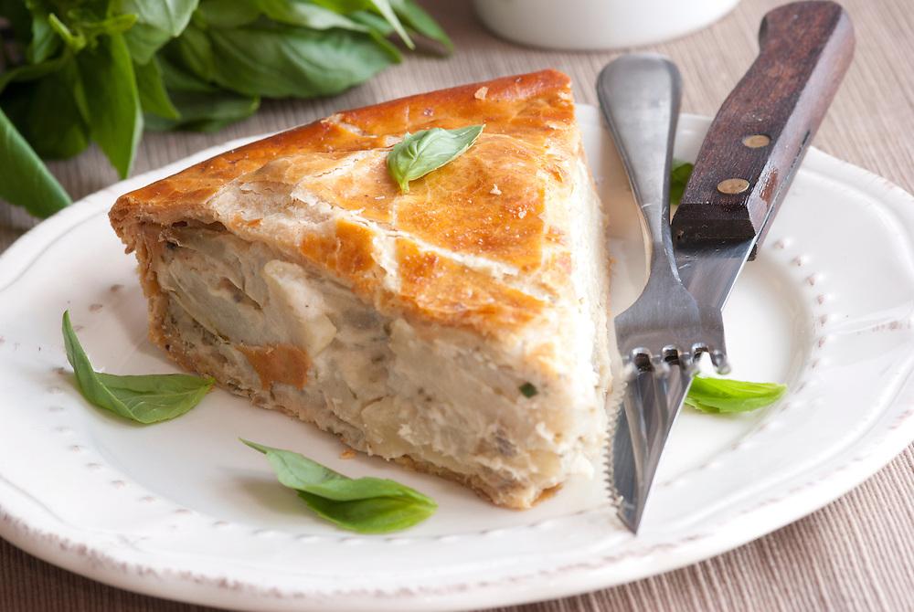 A slice of potato pie on a plate