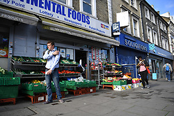 © Licensed to London News Pictures. 27/06/2019. London, UK. Intercontinental Foods shop on the Uxbridge Road near Shepherd's Bush where a teenager was fatally stabbed last night. Police were called at 9.20 PM on Wednesday, 26 June following reports of a stabbing. Officers found the male, believed to be aged 18 suffering from a stab injury but despite the efforts of paramedics the teenager died at the scene a short while later. Photo credit: Guilhem Baker/LNP