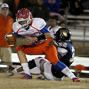 Randleman's Judson Petty is brought down by North Brunswick's Evin Bellamy. (Jason A. Frizzelle)