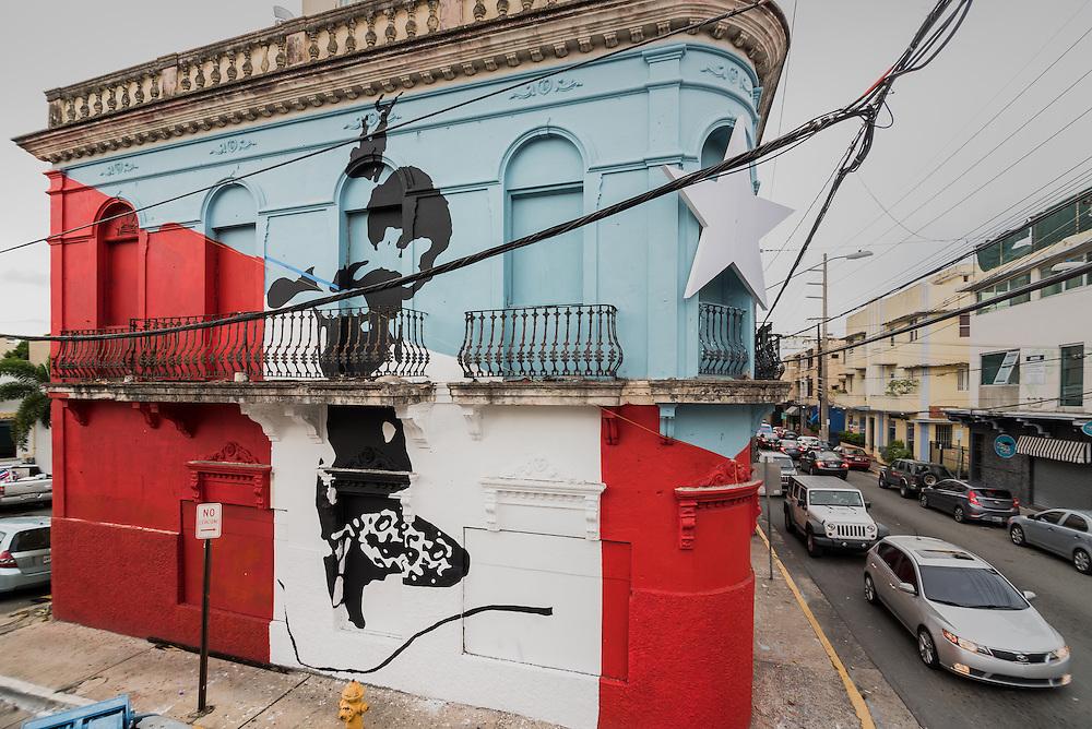 Edificio en la calle Loiza pintado por Artista Abey Charrón