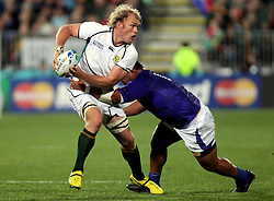 © Andrew Fosker / Seconds Left Images 2011 - South Africa's Schalk Burger gets his pass away under pressure  South Africa v Samoa - Rugby World Cup 2011 - North Harbour Stadium - Auckland - New Zealand - 30/09/2011 -  All rights reserved..