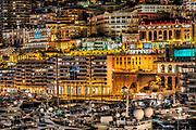 Downtown aparments and marina yachts at night, Monte Carlo, Monaco