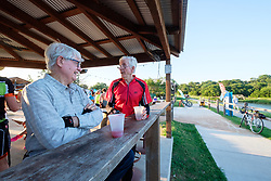 """Cyclists taking a sangria break after riding the """"Tour de Fort Worth"""" group ride on  the Trinity Trails on the Trinity River, Fort Worth, Texas, USA."""