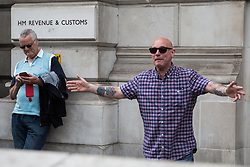 London, UK. 9th June, 2018. A supporter of Tommy Robinson, former leader of the far-right English Defence League, challenges anti-fascists protesting against the March for Tommy Robinson outside Downing Street.