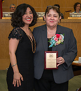 Juliet Stipeche and SanJuana Elizando pose for a photograph during the Houston ISD Board of Trustees meeting, May 14, 2015.