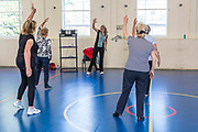 Local elderly members of the community take part in an exercise class at the Percy centre, Bath Somerset.