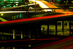 Light trails of cars passing by on the Houston freeways at night