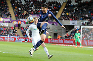 Son Heung-Min of Tottenham Hotspur gets to the ball ahead of Alfie Mawson of Swansea city.  The Emirates FA Cup, quarter-final match, Swansea city v Tottenham Hotspur at the Liberty Stadium in Swansea, South Wales on Saturday 17th March 2018.<br /> pic by  Andrew Orchard, Andrew Orchard sports photography.