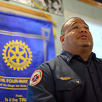 073014       Cayla Nimmo<br /> <br /> Albuquerque based EMS Captain Kerry McKinstry addresses the Rotary Club of Gallup at Sammy C's Restaurant in downtown Gallup Wednesday afternoon where he was honored for helping save the life of Juli Gartner.