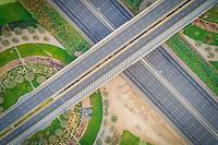 Aerial view of empty flyover roads in Dubai, UAE.
