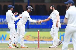 August 5, 2017 - Colombo, Sri Lanka - Indian cricketer Mohammed Shami (R) is congratulated by India's Ajinkya Rahane (2R) during the 3rd Day's play in the 2nd Test match between Sri Lanka and India at the SSC international cricket stadium at the capital city of Colombo, Sri Lanka on Saturday 5th August 2017. (Credit Image: © Tharaka Basnayaka/NurPhoto via ZUMA Press)