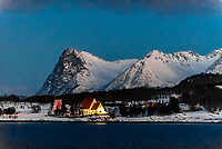 Winter landscape along the coastline near Harstad, Arctic, Northern Norway in predawn light.