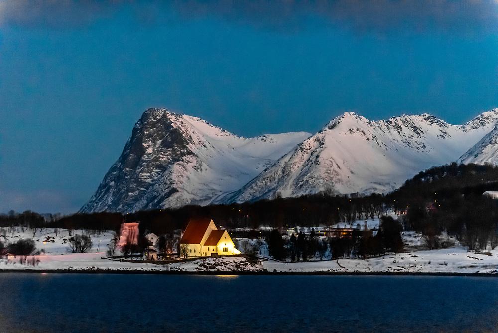 Winter landscape along the coastline near Harstad, Arctic, Northern Norway in predawn light.